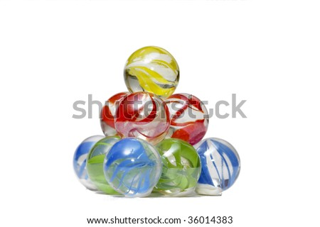 Glass marble balls pyramid macro shot over white background - stock photo