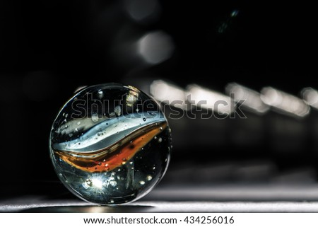 Glass marble red and blue colors inside - stock photo