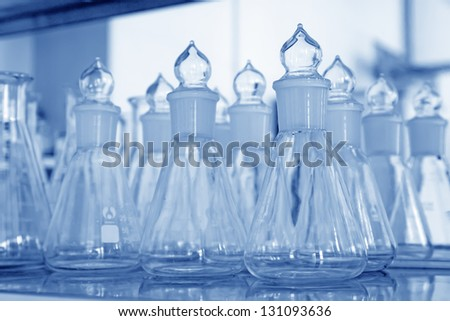 glass material chemical laboratory glassware in a laboratory - stock photo