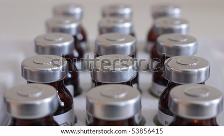 Glass medicine bottles with injection fluid with aluminium caps - stock photo