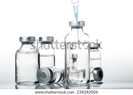 Glass Medicine Vials and botox hualuronic collagen and flu syringe. - stock photo