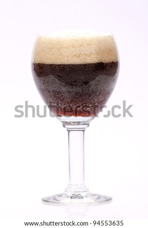 glass of a dark beer on a white background