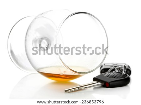 Glass of alcoholic drink and car key, isolated on white - stock photo