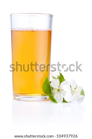 Glass of apple juice and flowers isolated on white background
