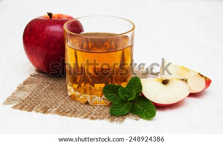 Glass of apple juice and fresh red apple - stock photo