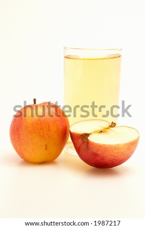 Glass of apple juice isolated on white
