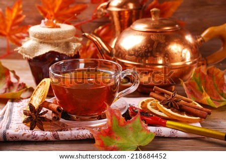 glass of autumn tea with orange ,spices and honey - stock photo