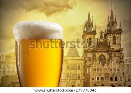 Glass of beer against Tyn Church in Prague - stock photo