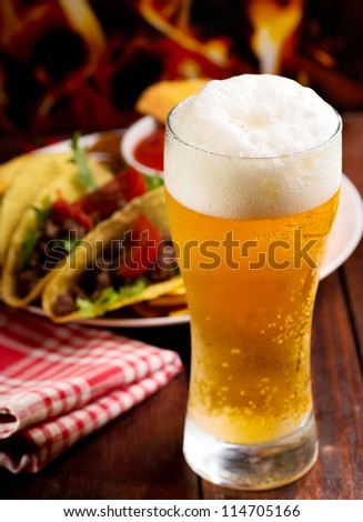 glass of beer and different snack - stock photo