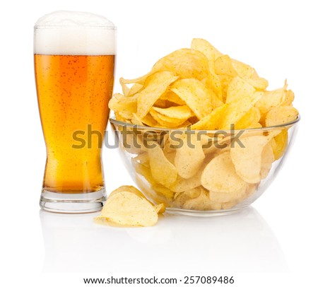 Glass of beer and Potato chips in glass bowl isolated on white background - stock photo