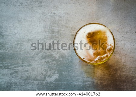 Glass of beer on a concrete table