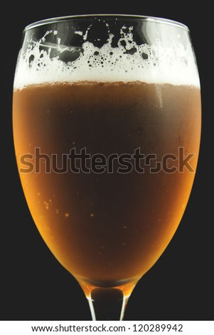 Glass of beer on a dark background | Closeup