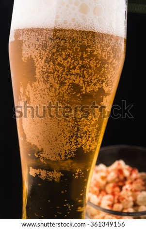 glass of beer on black background
