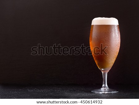 glass of beer on dark background - stock photo