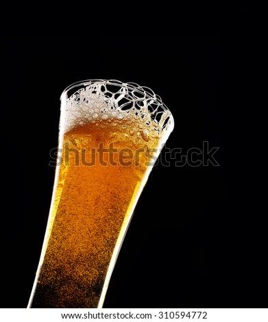 glass of beer on dark black background - stock photo