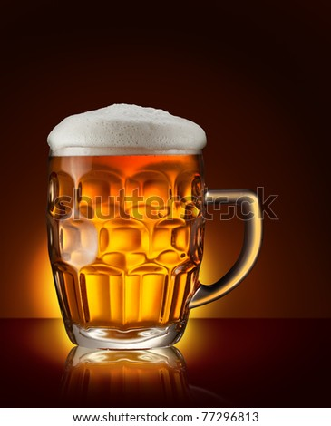 Glass of beer on the dark brown background - stock photo
