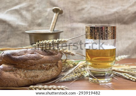 Glass of beer with barley on table. Selective focus. - stock photo