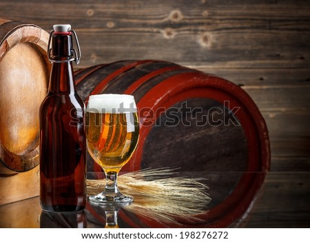 Glass of beer with bottle - stock photo