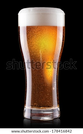 glass of beer with foam isolated on black background  - stock photo