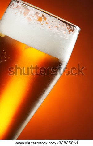 Glass of beer with froth close up