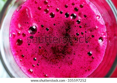 Glass of beet juice close up - stock photo