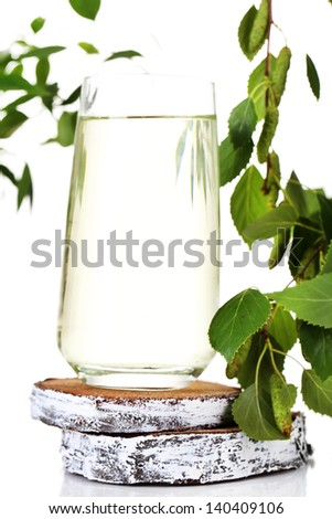 Glass of birch sap, isolated on white - stock photo