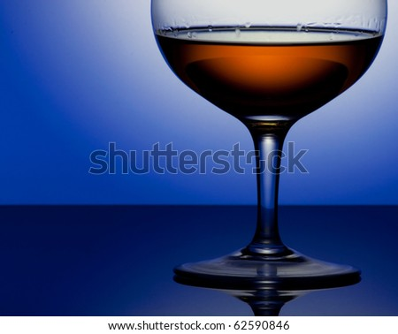 Glass of brandy on a circle white background