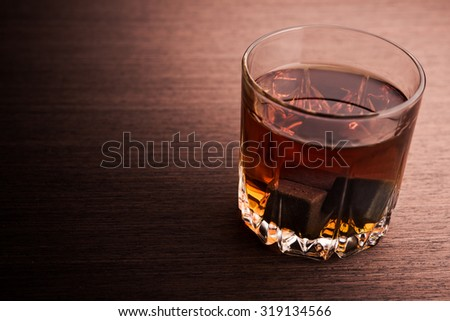 Glass of brandy on background. - stock photo