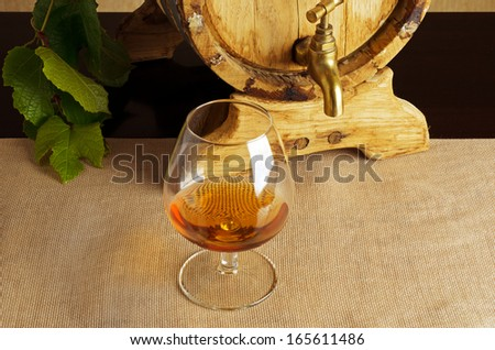 Glass of brandy on the table. - stock photo