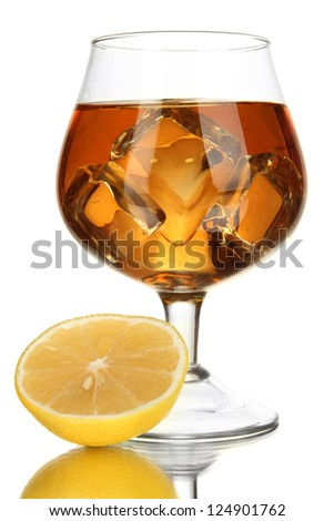 Glass of brandy with ice and lemon isolated on white - stock photo