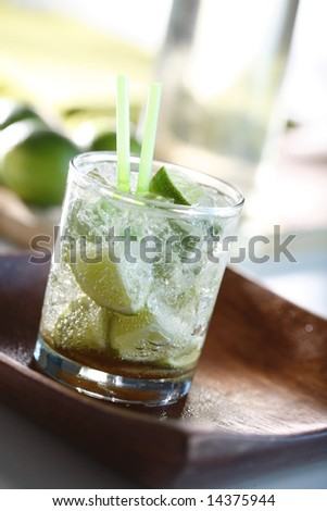 Glass of Caipirinha with lime, Cachaca, sugar and ice cubes