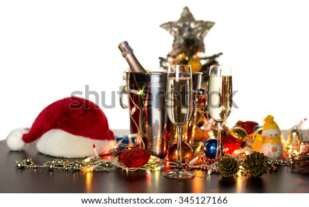 Glass of Champagne and Christmas decorated isolated on white background - stock photo