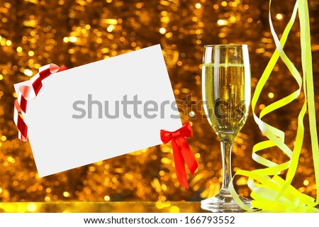 Glass of champagne and empty card - stock photo