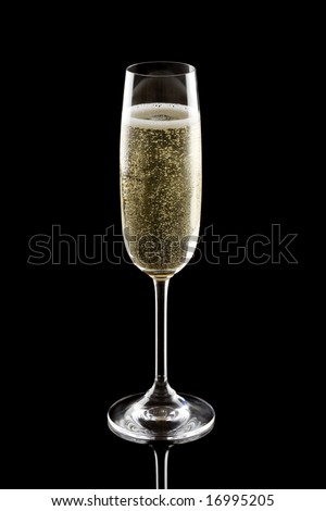 Glass of champagne isolated on a black background - stock photo