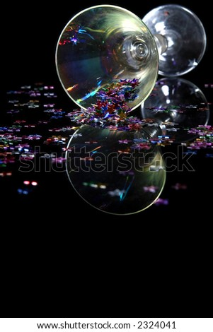 Glass of champagne on a black background - stock photo