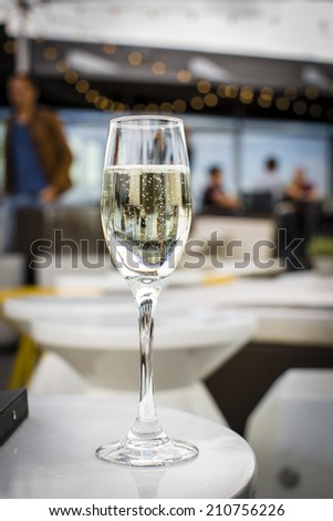 Glass of champagne on a lounge bar table