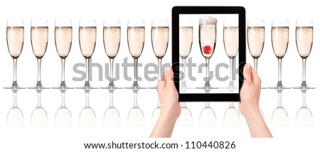 glass of champagne on tablet computer screen  isolated on a white background - stock photo