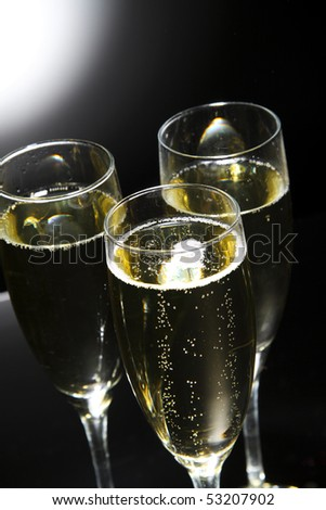 Glass of champagne over white - stock photo