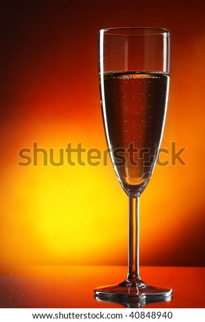 Glass of champagne over yellow background close-up - stock photo