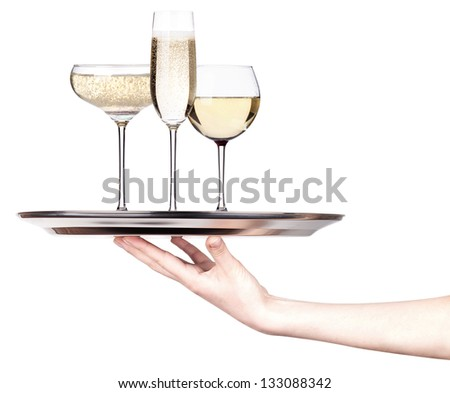 glass of champagne set isolated on a silver tray white background - stock photo