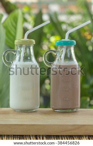 Glass of Chocolate and Fresh Milk on the table