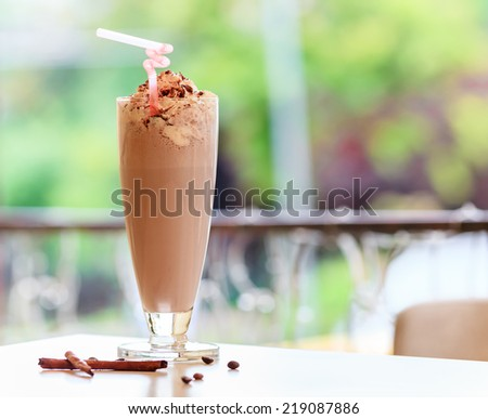 Glass of chocolate milkshake with whipped cream - stock photo