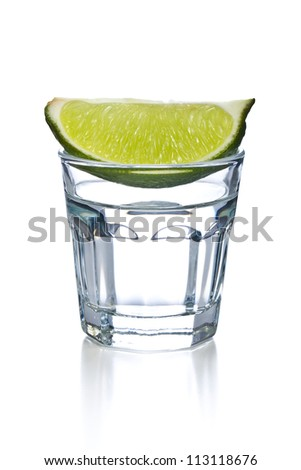 glass of clear alcohol on white background - stock photo