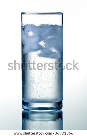 Glass of clear mineral water with ice cubes. HQ studio shot.