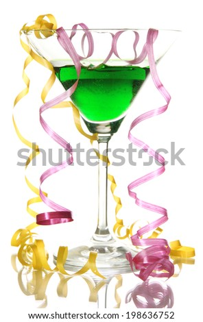 Glass of cocktail and streamer after party isolated on white - stock photo