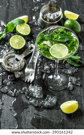 Glass of cocktail with lime, mint, ice. Tonic water, mojito, caipirinha. Top view - stock photo