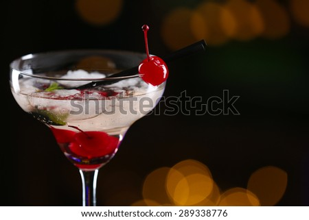 Glass of cocktails on bar background