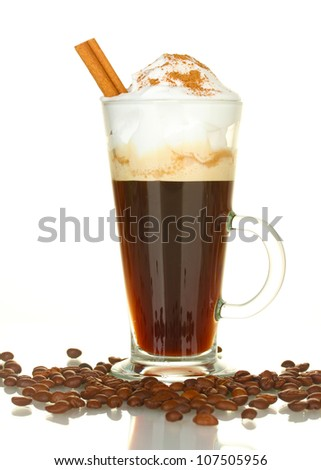 glass of coffee cocktail with coffee beans and cinnamon on white background close-up