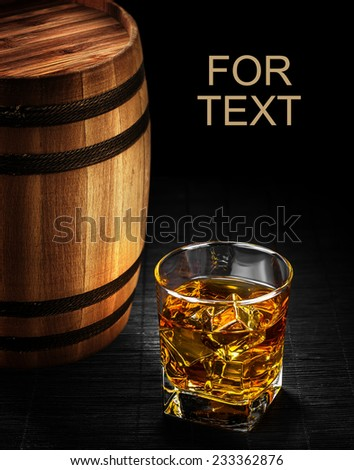 Glass of cognac on the vintage wooden barrel  - stock photo