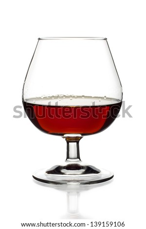 Glass of cognac on the white background - stock photo